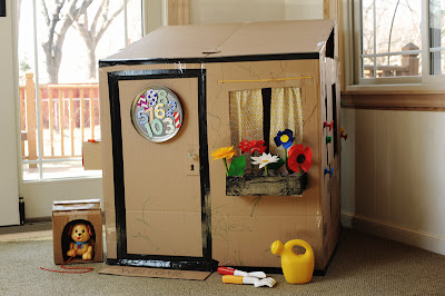 Rust sunshine cardboard playhouse for Cost to build a playhouse