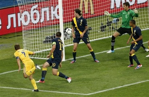 Ukraine forward Andriy Shevchenko scores his side's winning goal against Sweden