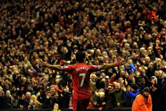 Liverpool forward Luis Suárez celebrates after scoring his team's second goal against Hull