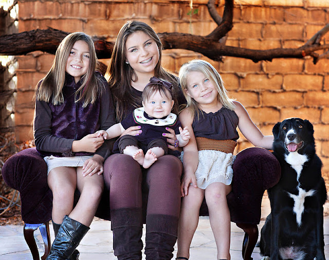 Children including family dog pose for a Christmas portrait in Tucson backyard