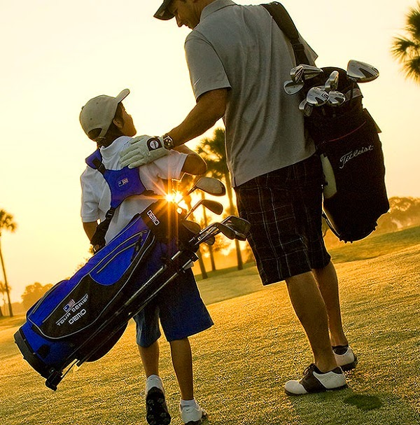 Father and son golfing togethe