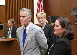 Woodward introduces a newly sworn in Assistant U.S. Attorney to federal Judge Claire Eagan