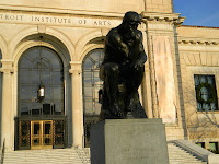 statue of The Thinker in front of the Detroit Institute of Arts
