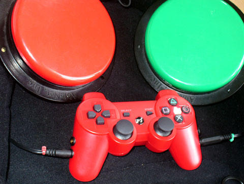 Switch adapted PS3 P3 red Joypad controller with two large able net switches connected to the L2 and R2 sockets.