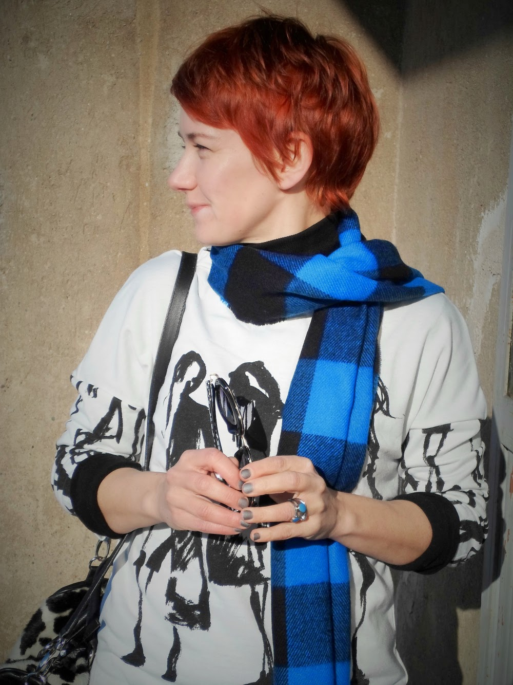Graffiti sweater, plaid scarf, a smile and short red hair; Funky Jungle