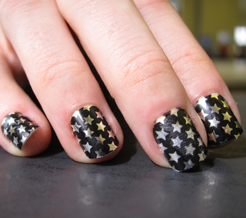 Black Nail Art with Silver and Golden Stars