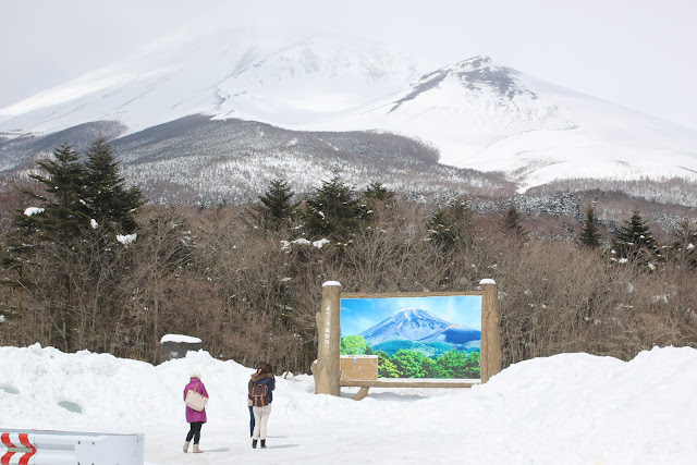 Taking the view of Mount Fuji which is covered fully with snow at the Mount Fuji 2nd station in Japan