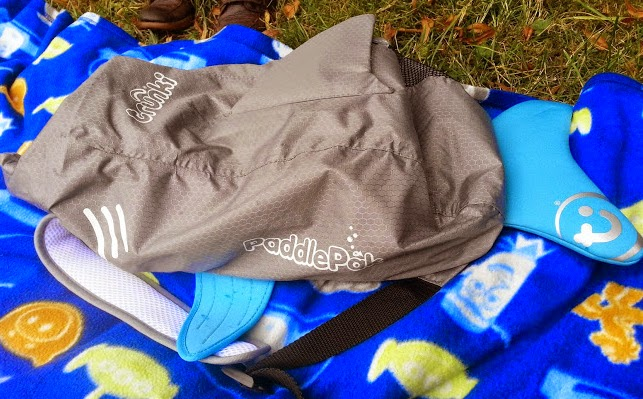 A Paddlepak from Trunki lying flat on blanket in rain