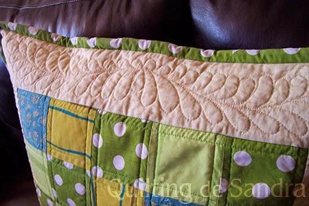 Cojin acolchado en verde detalle