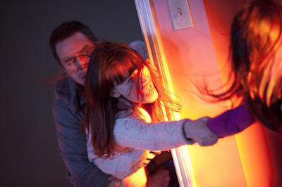 Sam Rockwell and Rosemary Dewitt in Poltergeist (2015)
