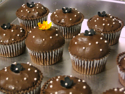 Extra Cupcakes with Black Flowers and Yellow and Orange Flower - Close-Up