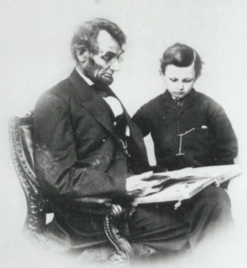 Lincoln reads with his son, Tad