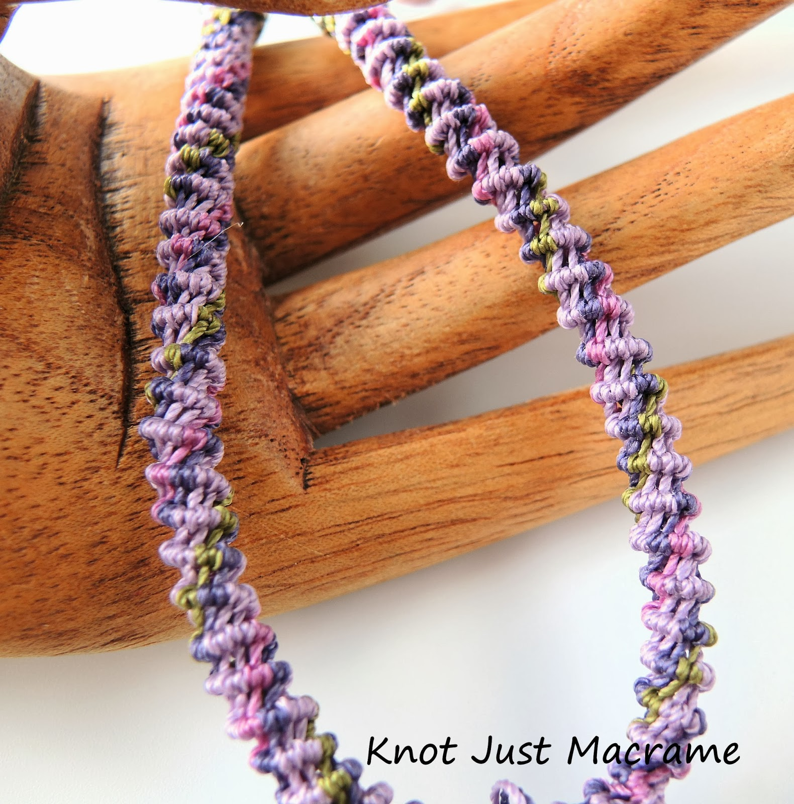 Knotted micro macrame spiral in shades of orchid, purple and olive