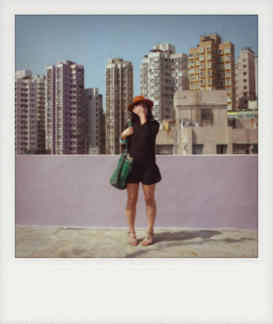 black dress hong kong polaroid rooftop