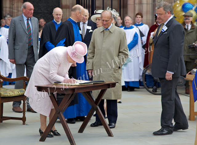 HM The Queen signing book at Hereford Cathedral. Photo © Jonathan Myles-Lea