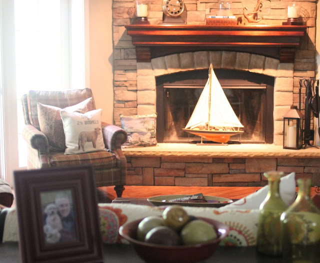 corner stacked stone fireplace with plaid chair - www.goldenboysandme.com
