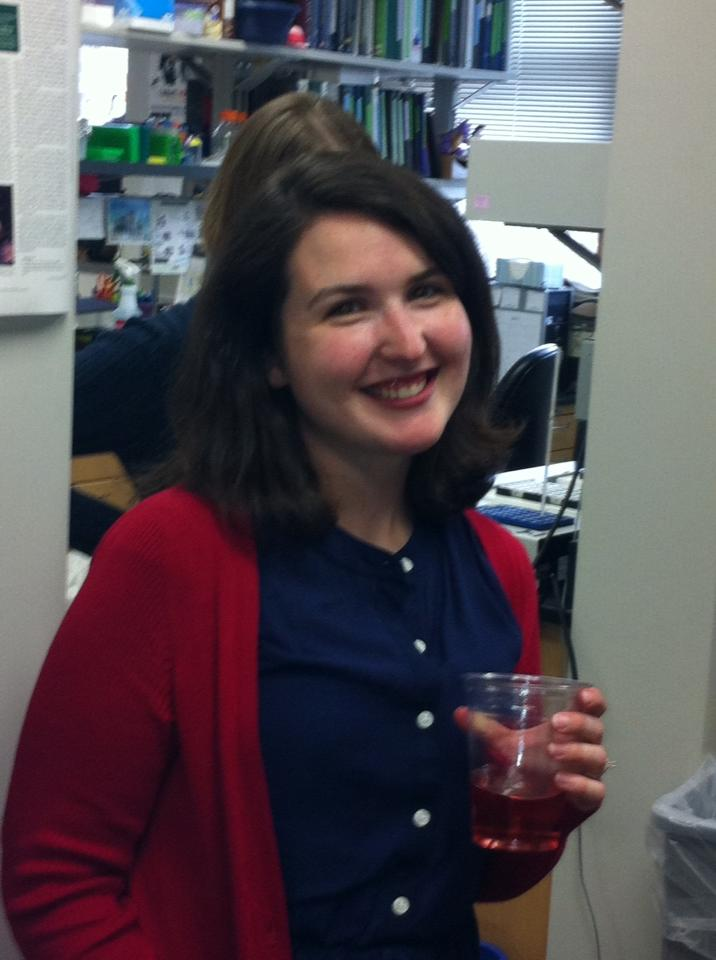 After hearing she passed her PhD defense, Sara celebrates in lab with her friends and family
