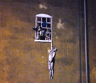 The Banksy artwork Well Hung Lover on Park Street in Bristol