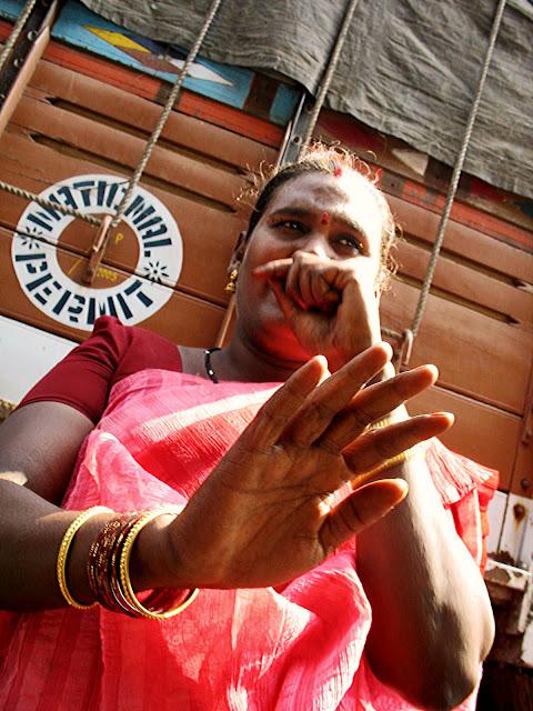 hijra beggar in pink saree