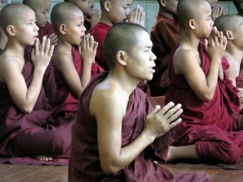 Monks in Kyaiktiyo Pagoda, Myanmar. June 2012.