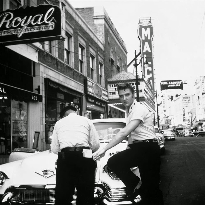 Tdclass tr caption align centermemphis 1956 elvis presley outside jims barber shop on south main street looks like hes gettin a ticket and