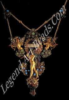 """The """"Omphale"""" necklace designed by Eugene Grasset in 1900; gold, silver, enamel, red jasper, rubies, turquoises, emeralds and brilliant-cut diamonds."""