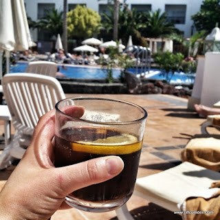 rum and coke by the pool