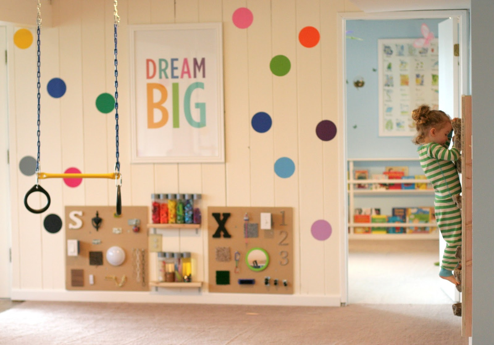Confetti decal wall with DIY sensory boards by Fun at Home with Kids