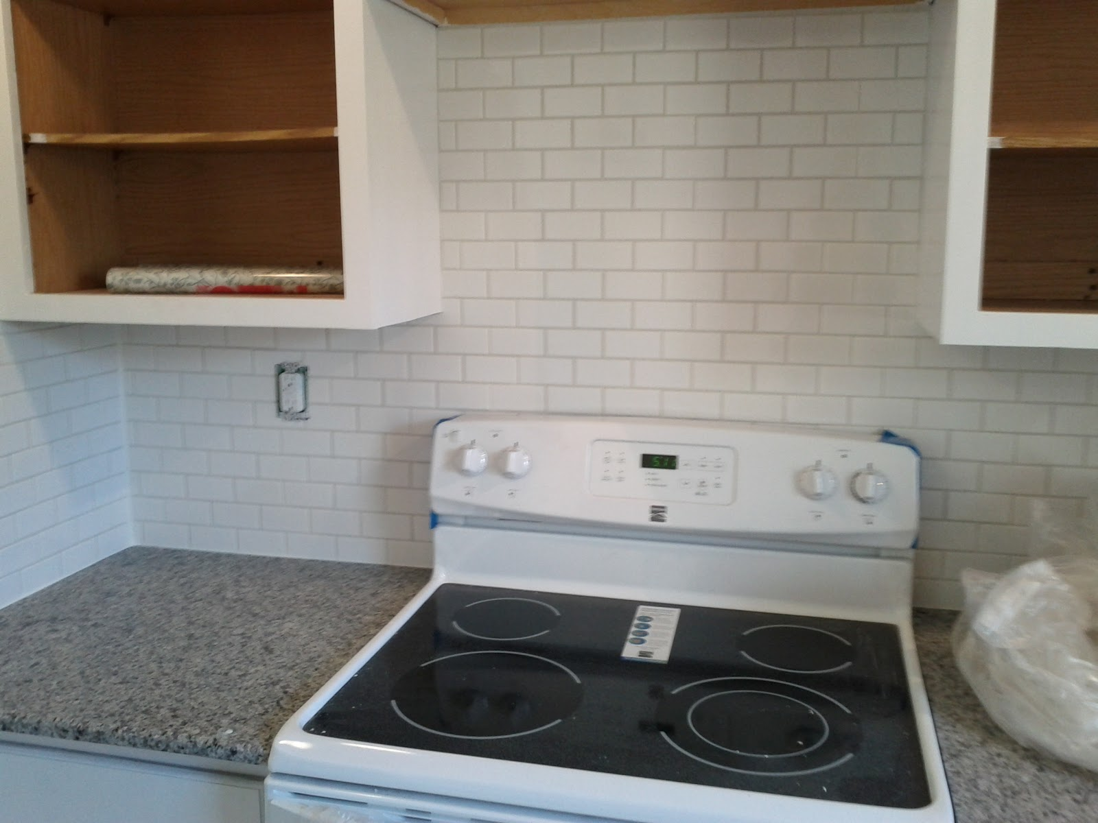 White Cabinets and Azul Platino Granite