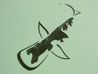 Whale shark image stenciled on a wall in Isla Holbox