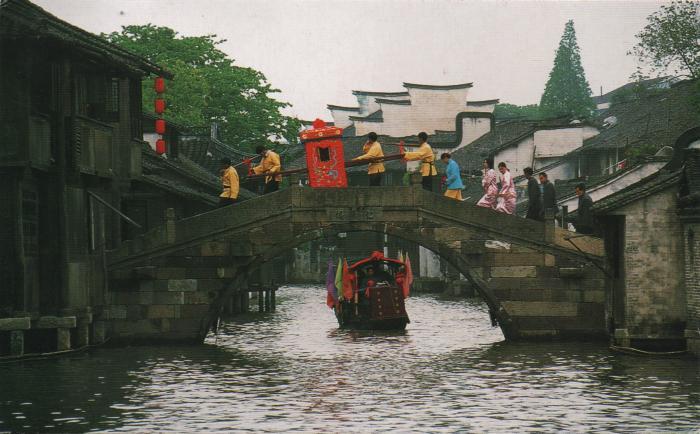 bridal procession crossing stone bridge