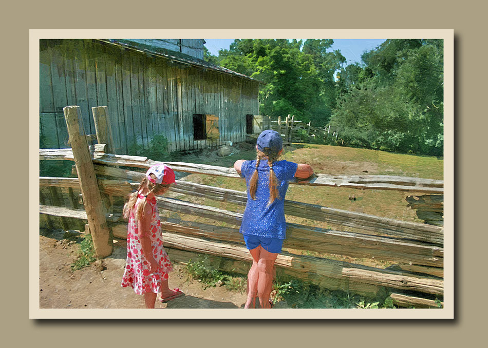 Two little girls looking over the fence by the Stong grain barn at Black Creek Pioneer village.  Holly Cawfield Photography