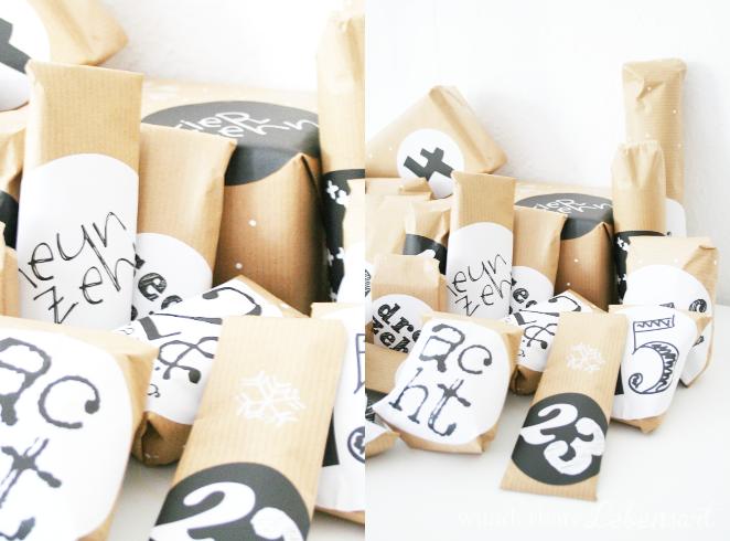 Adventskalender mit verzierten Geschenkpapier und Typoschilder