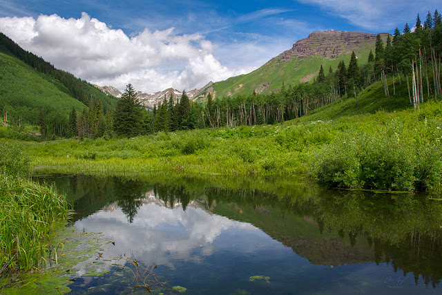Teocalli Mountain reflected in a small pond near Crested Butte, Colorado