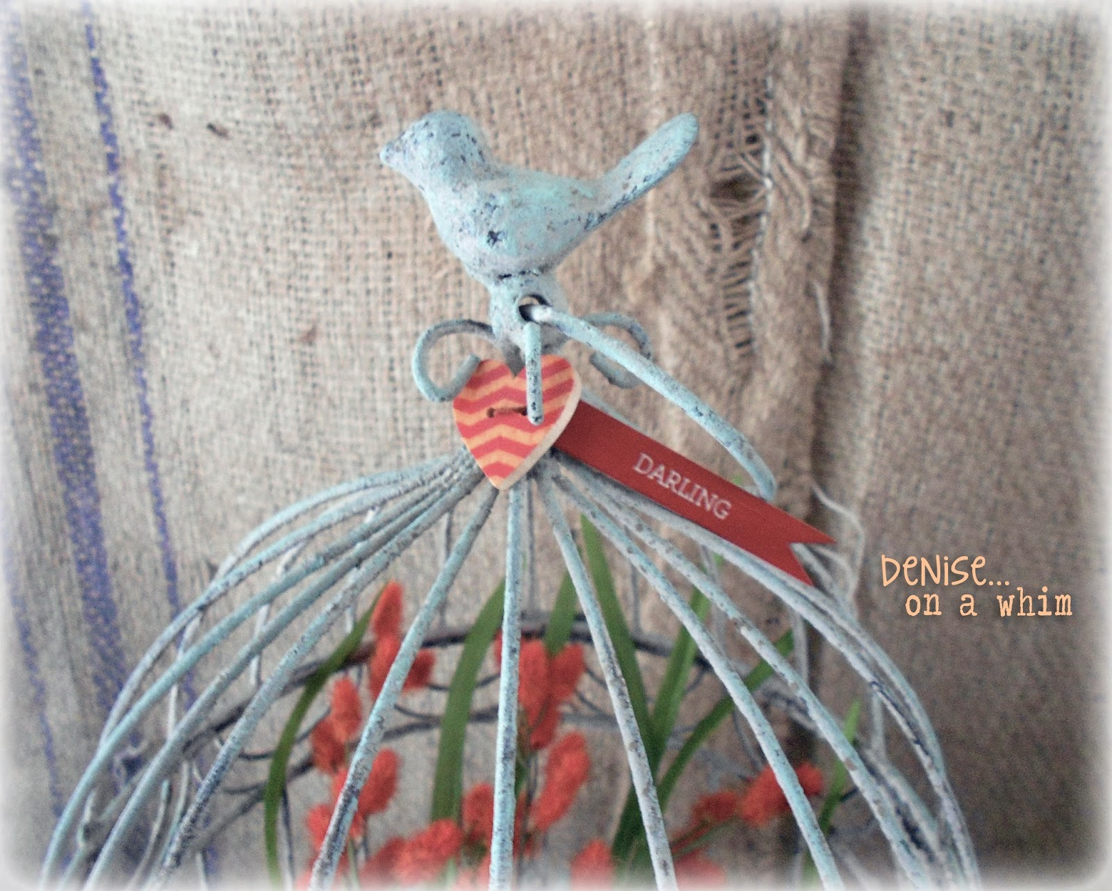 Wooden Button Embellishments on a Shabby Birdcage via http://deniseonawhim.blogspot.com
