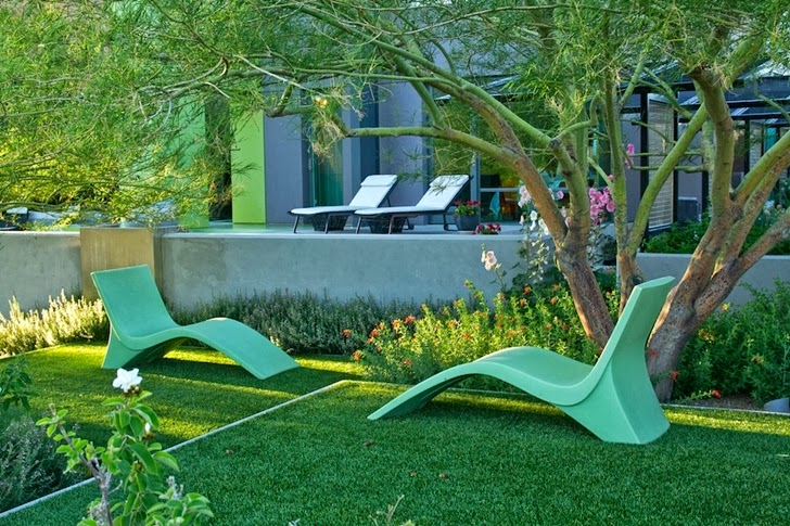 Chairs in the grass in Multimillion modern dream home in Las Vegas