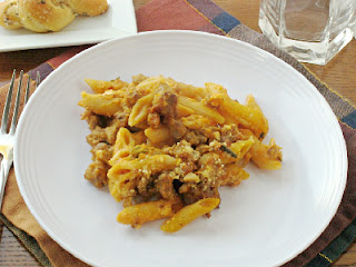 pumpkin sausage pasta on a white plate