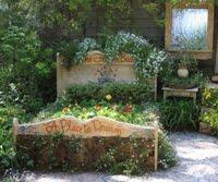 ♥ aqui o jardim é mágico, com uma cama para sonhar...