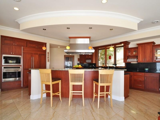 Photo of wooden kitchen with the island in the middle