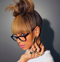 Beyoncé wearing gold name earrings