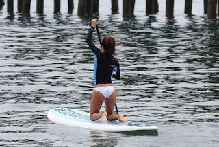 Eva Longoria paddle boarding in Malibu on her knees