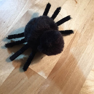 cute black pom pom spider
