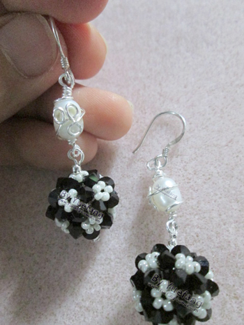 Caged_pearl_earrings_with_three_leaves_wire_clover