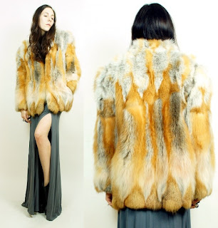 Vintage 1980's fluffy red fox fur coat with white and brown dimensional coloring and front hook and eye closure.