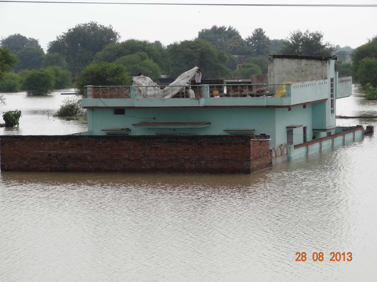 Varanasi House Surrounded By Flood Water Of River Ganga