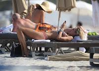 Lauren Stoner in a Bikini relaxing on the beach in Miami
