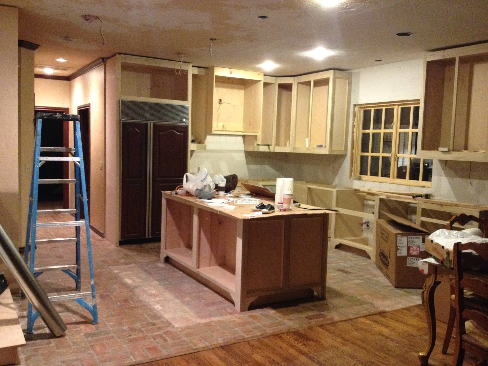 Lowered cabinets and yes, we have cardboard on the island. Remember