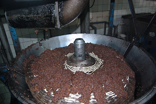 "Putting crushed mass on the ""capachos""."