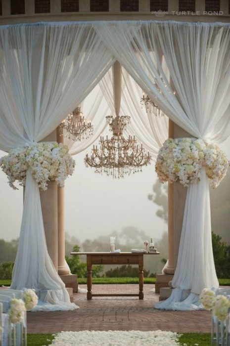 chandelier wedding drapery arbor