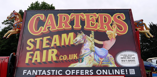 Carters Steam Fair advertising hoarding